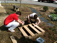 with direct supervision and proper instruction, these 7th graders are using power tools and basic carpentry skills to build their own composting unit for the school garden