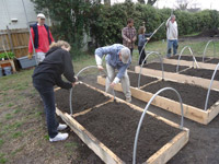 building a 8 raised bed garden is a huge undertaking, but it only took this group a few hours working together